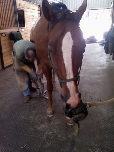 Holding a boot while getting a trim